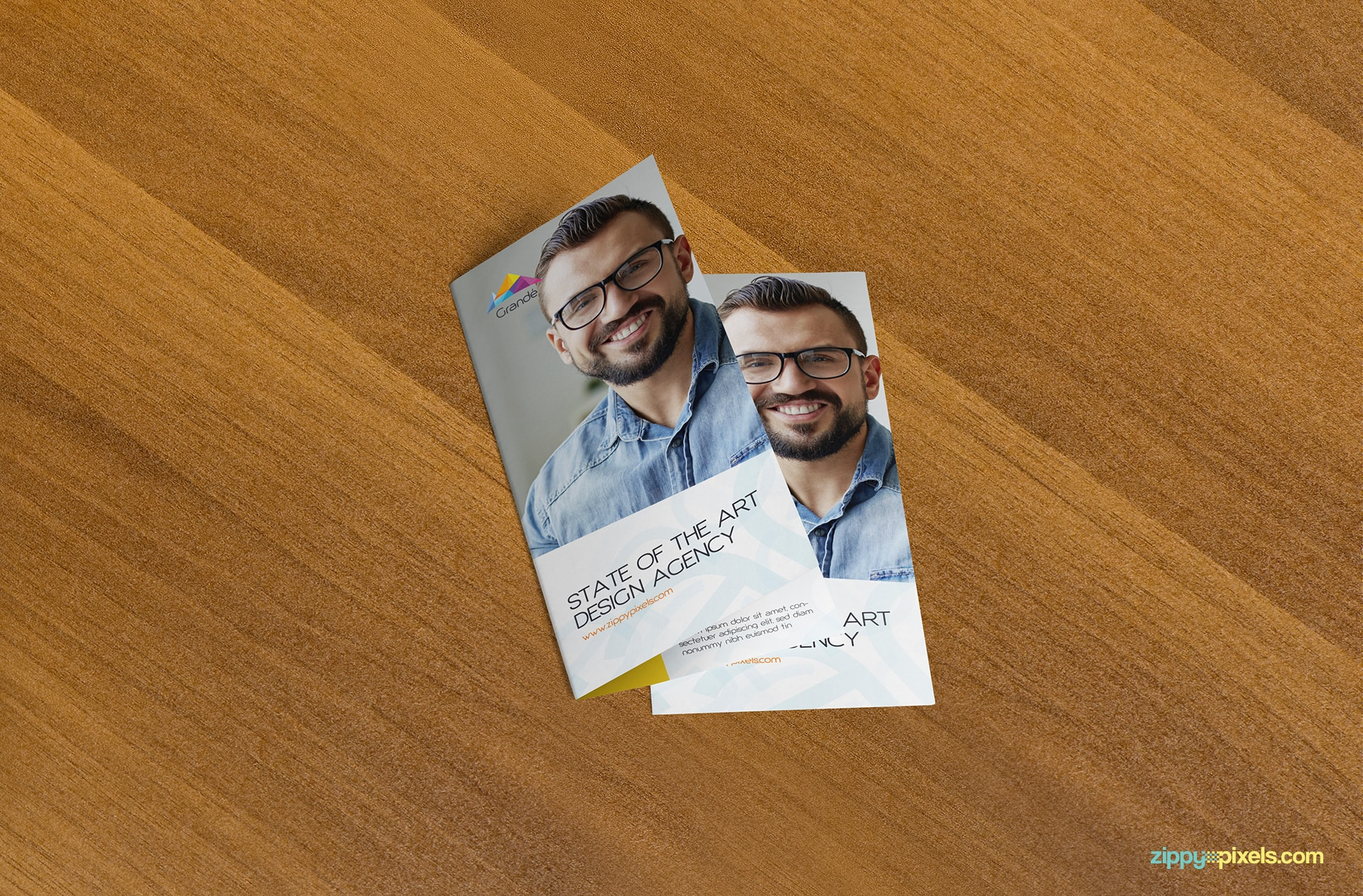 2-bi-fold-flyers-on-wooden-surface-closed