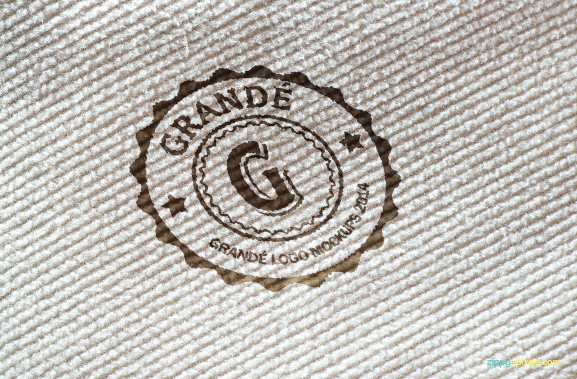 Mockup of Printed Logo on White Carpet