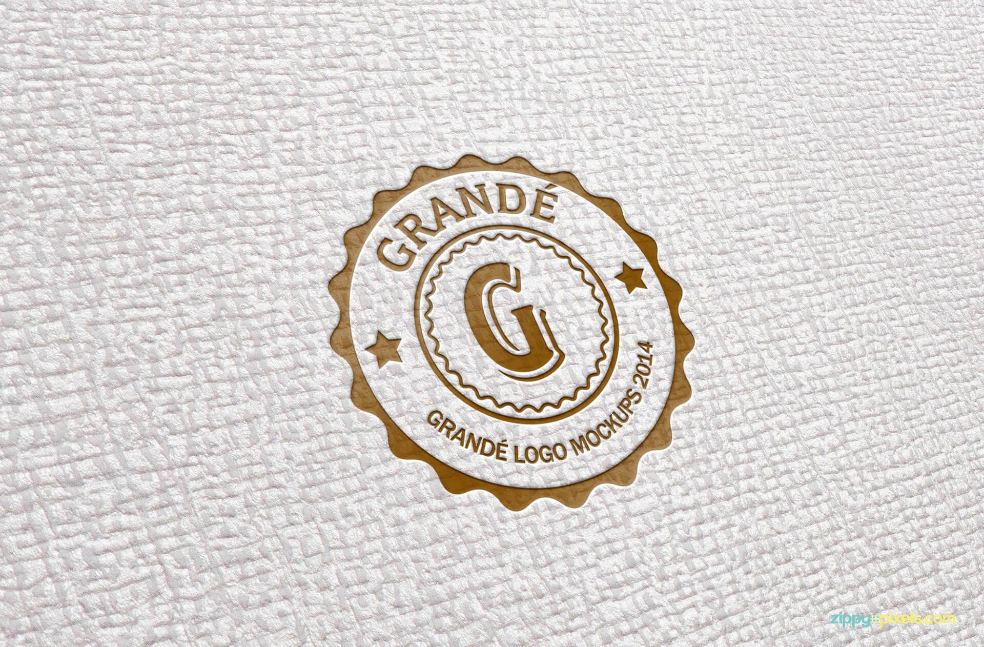 PSD Mockup of Letterpressed Logo on Textured Paper