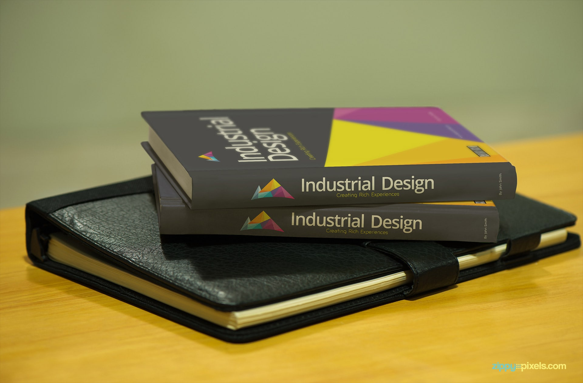 Books Cover Mockup showing Two Books upon Leather Diary on Table
