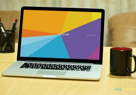 Free Photorealistic Device Mockup of Macbook Pro