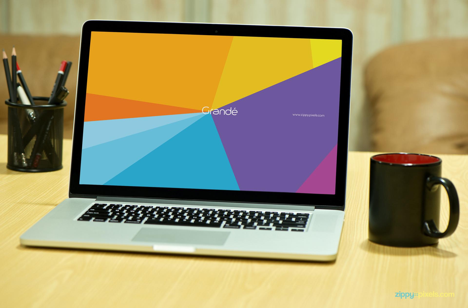Macbook Pro with Black mug on Table for Mockup