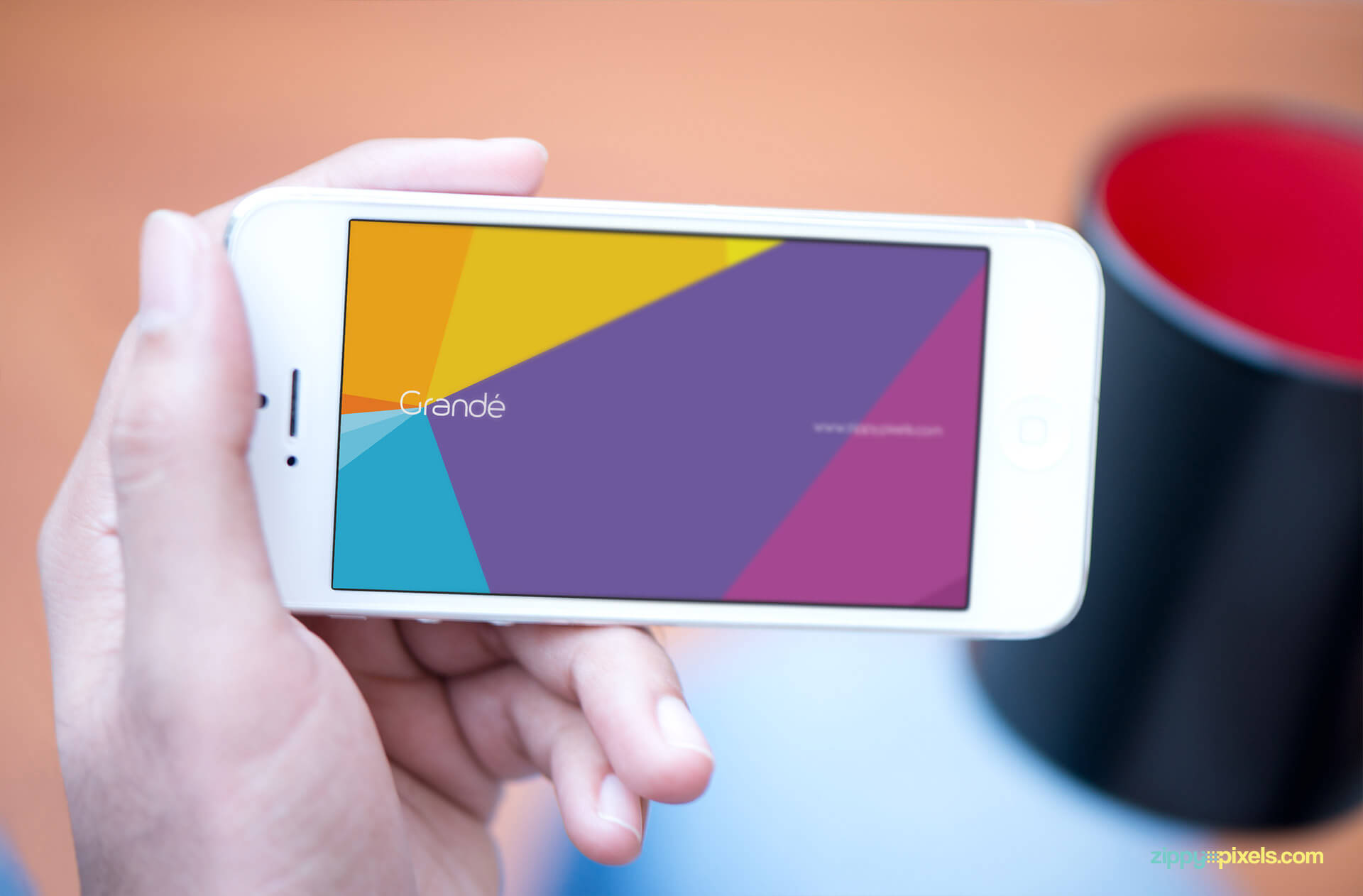 Device Mockup of iPhone Held in Hand in Landscape