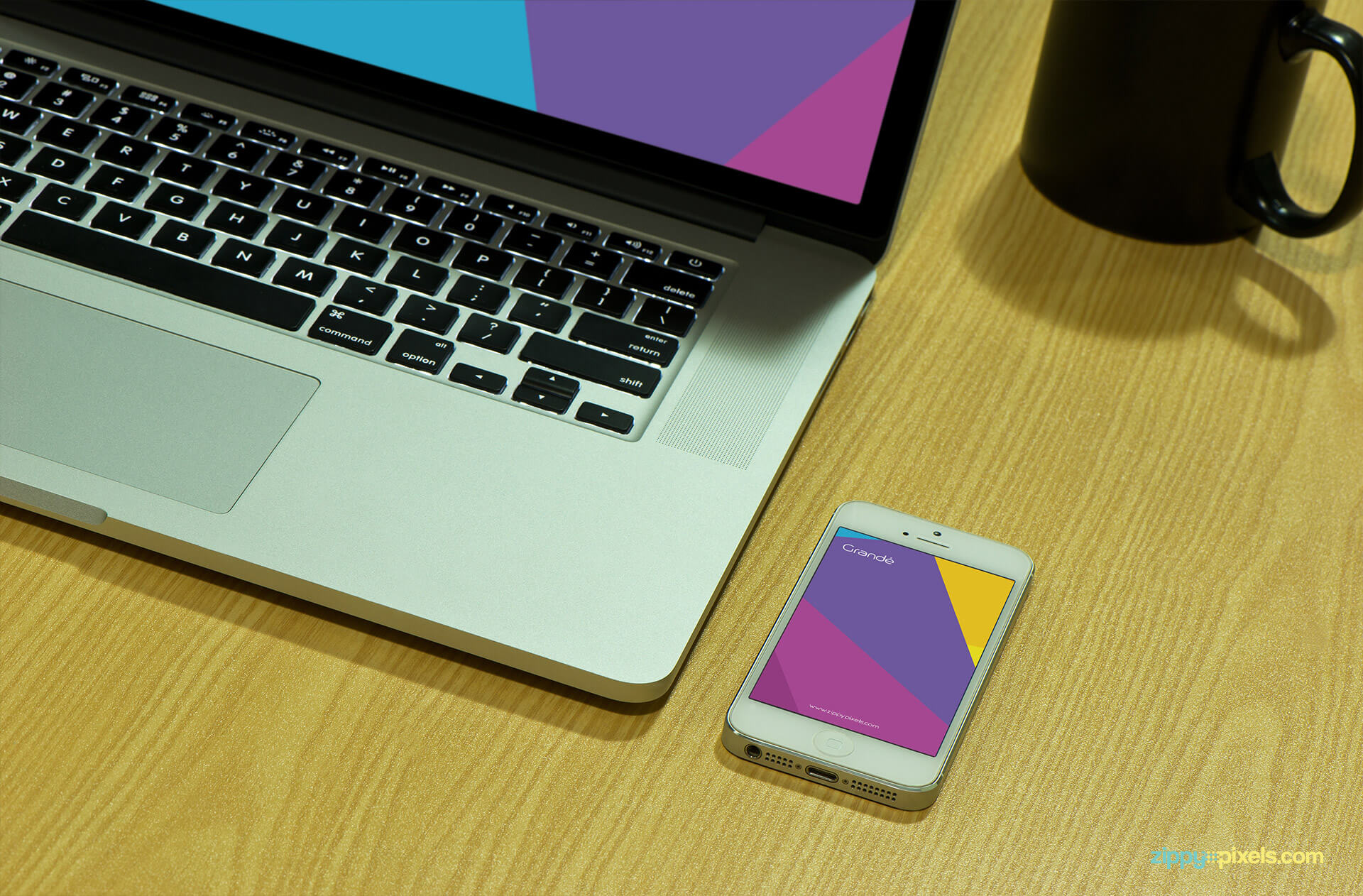 iPhone Mockup shows iPhone lying on table with Macbook Pro