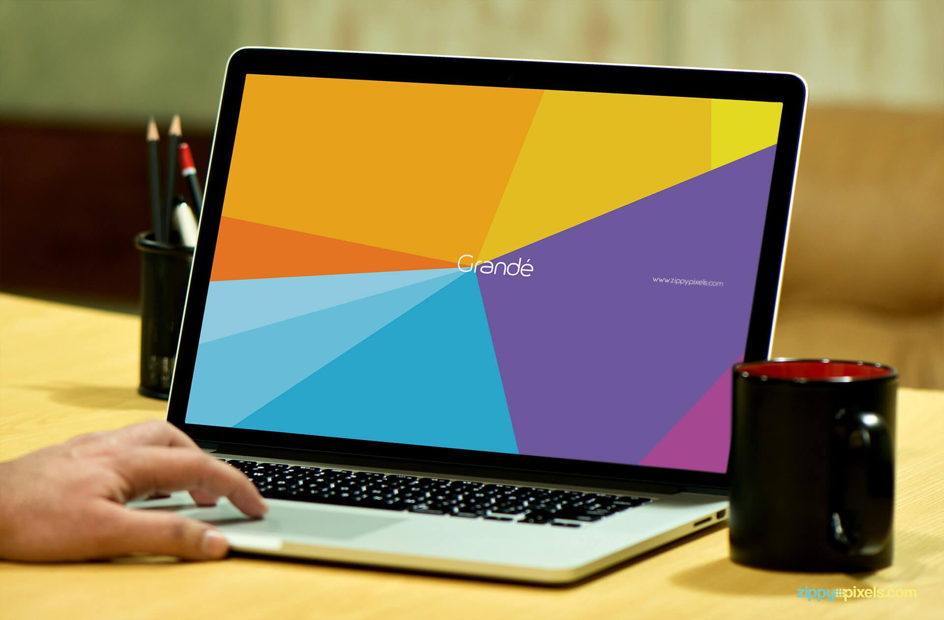 Device Mockup of Macbook Pro on Table with Coffee Mug