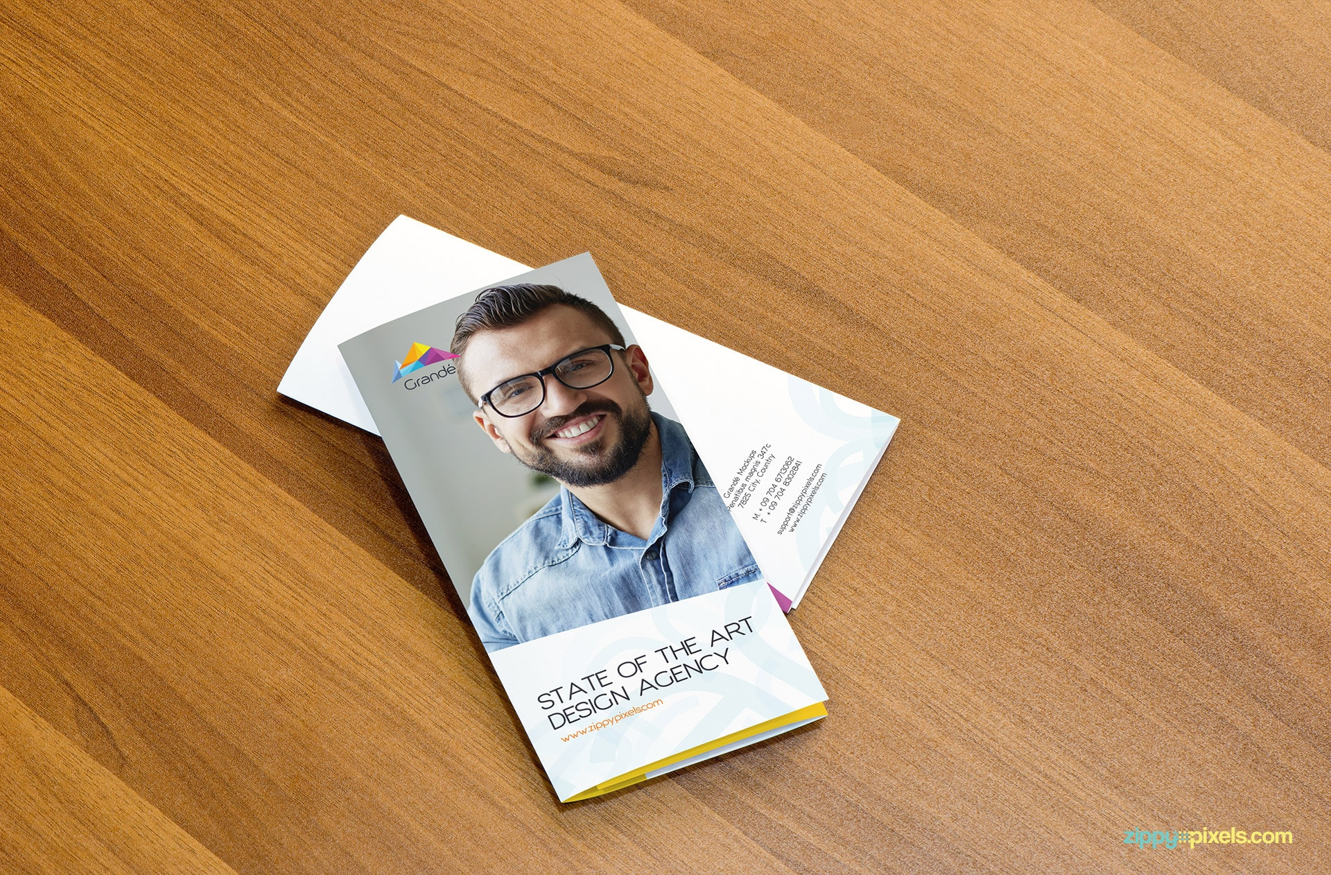 Mockup of 2 Trifold Flyers Folded Place on Top of Each Other