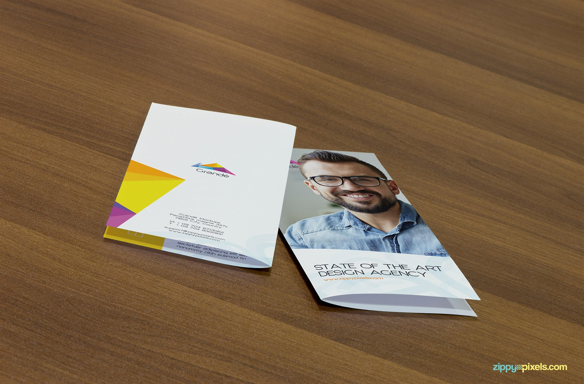 Mockup of 2 Bifold Flyers on Table Showing Front and Back