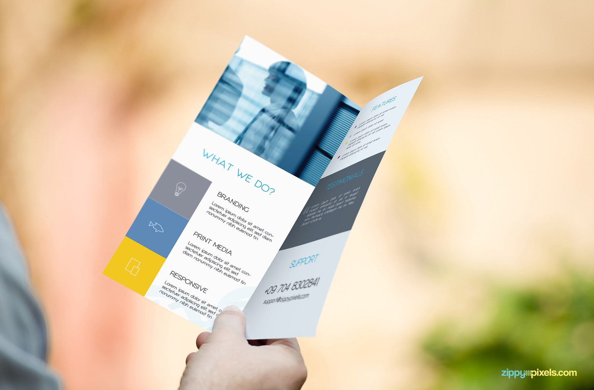 Mockup of Bifold Flyer in Hand