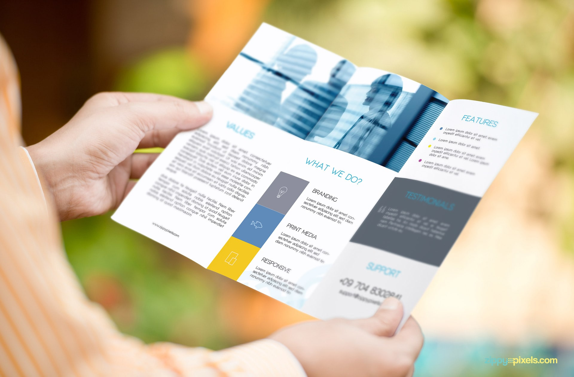Mockup of Trifold Flyer Held in Both Hands