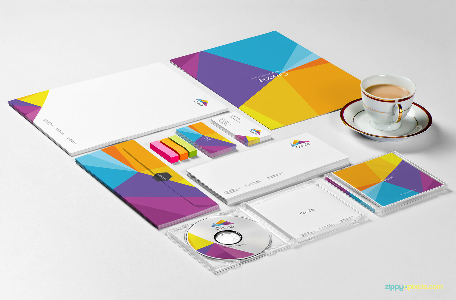 Comprehensive Stationery Branding Mockup of File Folder, Letterhead, Envelope, Business Cards & CD Cover with Tea Cup & Erasers