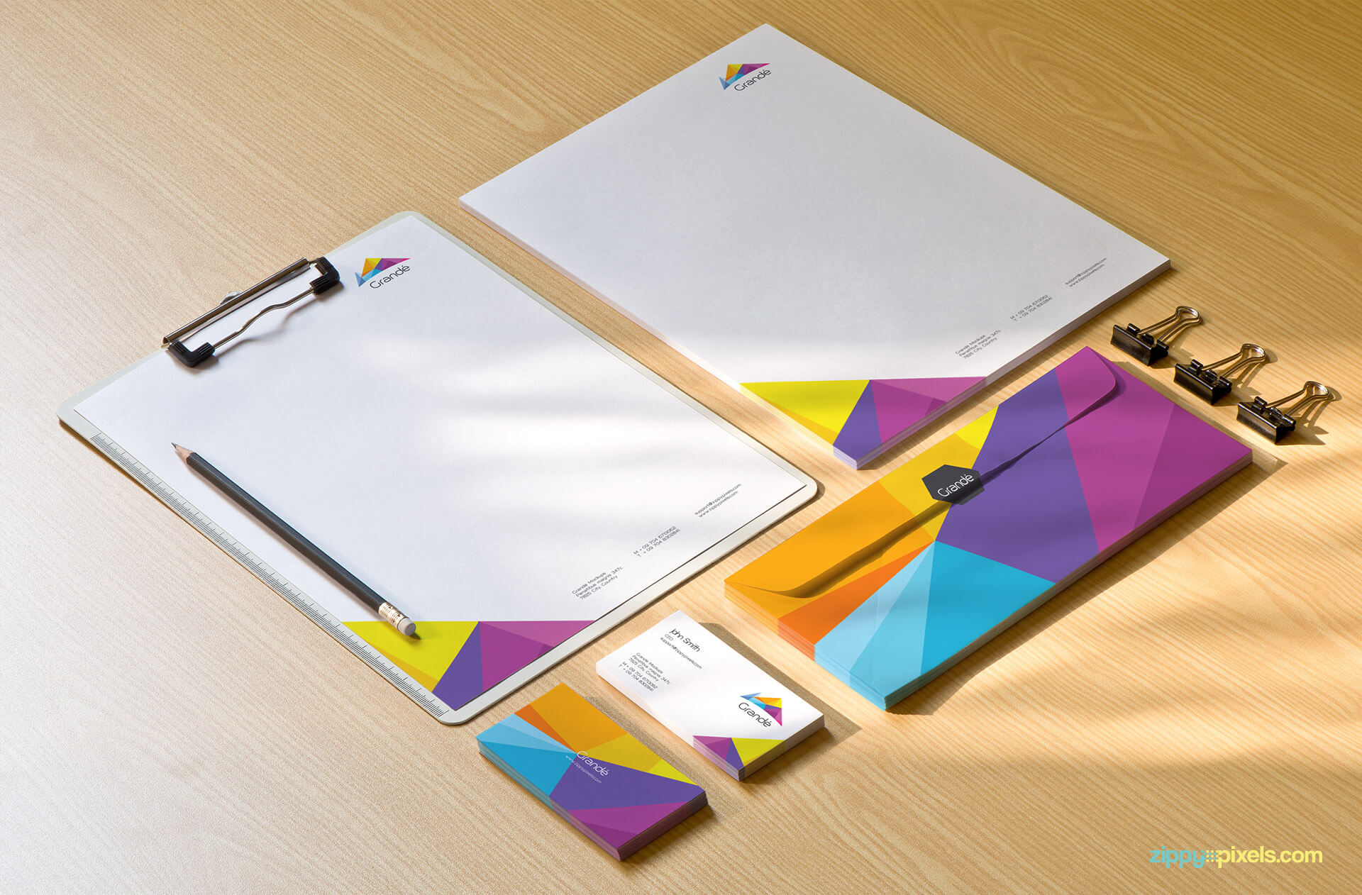 Corporate Identity Mockup of clipboard, letterhead, business cards, pencil and clips.