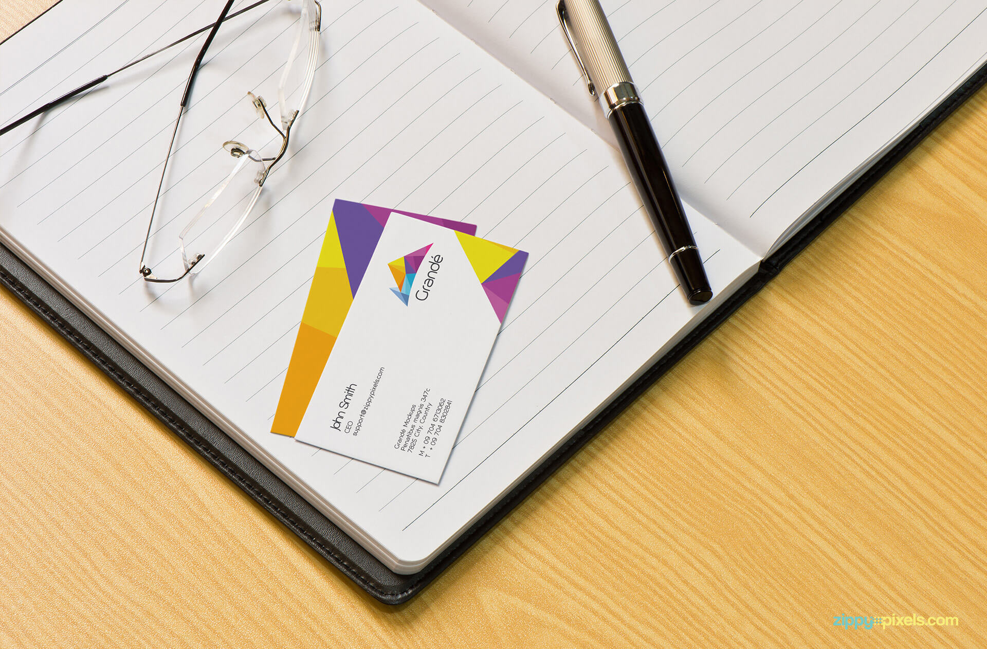 Brand Identity Mockup of 2 Business Cards on Diary with Pen and Spectacles