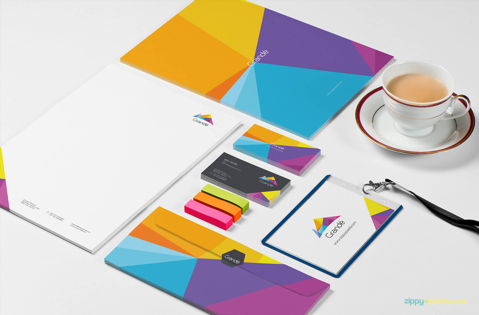 Stationery Branding Mokcup of Set of Letterheads, Business Cards, Envelopes, Id badge holder with Erasers & Tea Cup