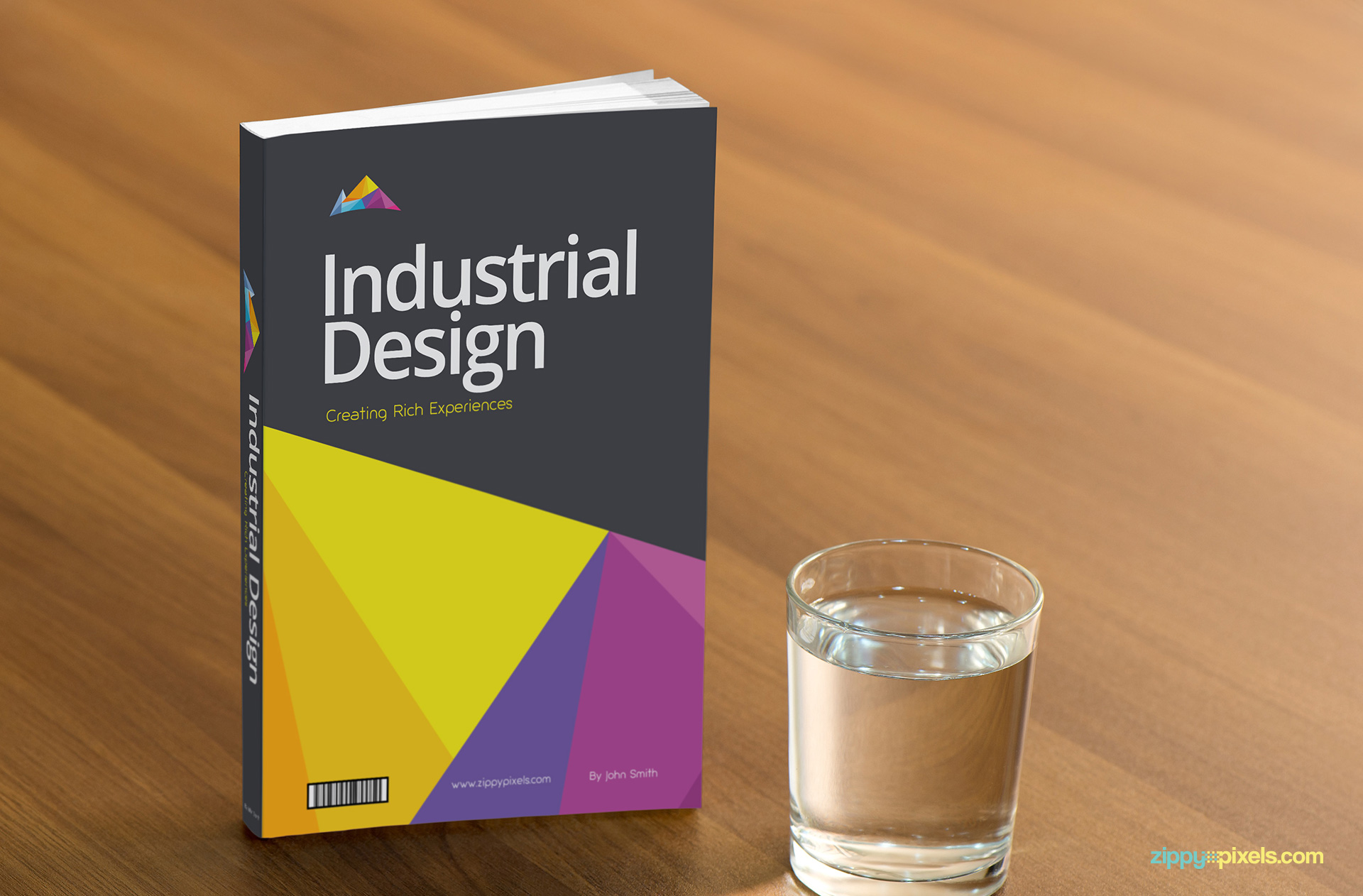 Free Book Cover Mockup of a paperback book with glass of water