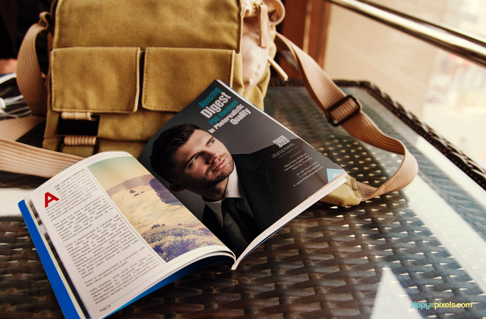 Mockup of opened paperback digest lying on table with bag on side