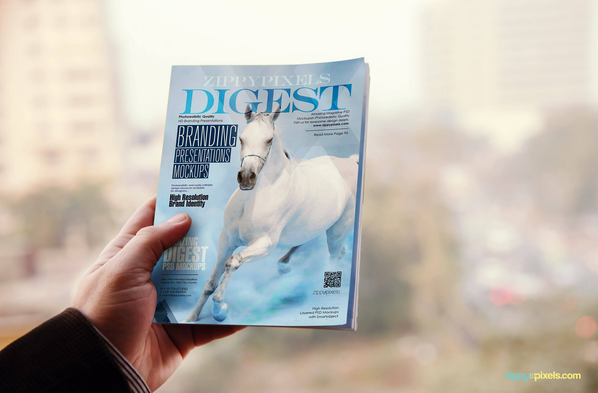 PSD magazine mockup of digest held in one hand showing front cover