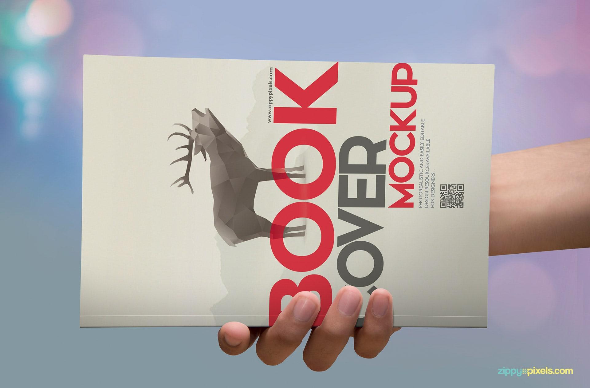 Closeup shot of horizontal softcover book in photorealistic mockup