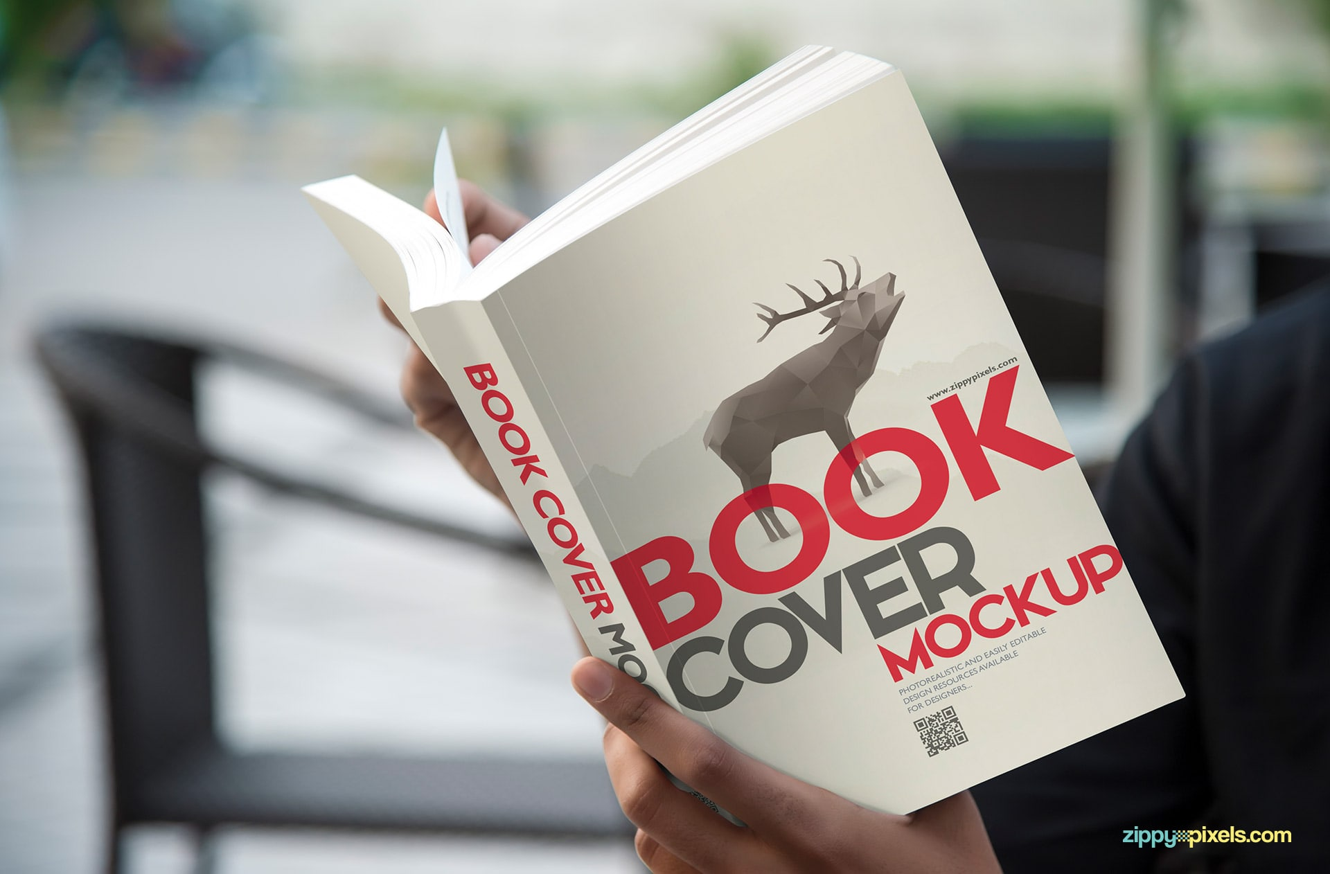 Book cover mockup - person holding paperback book in hands for showcasing cover design