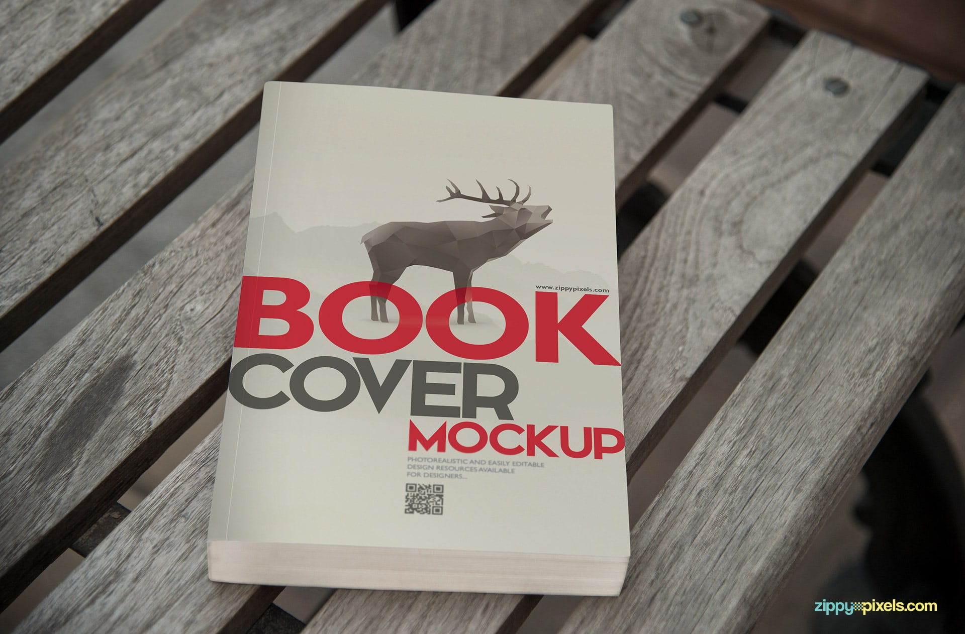 Book mockup of zoomed in view of paperback book lying on wood plank bench