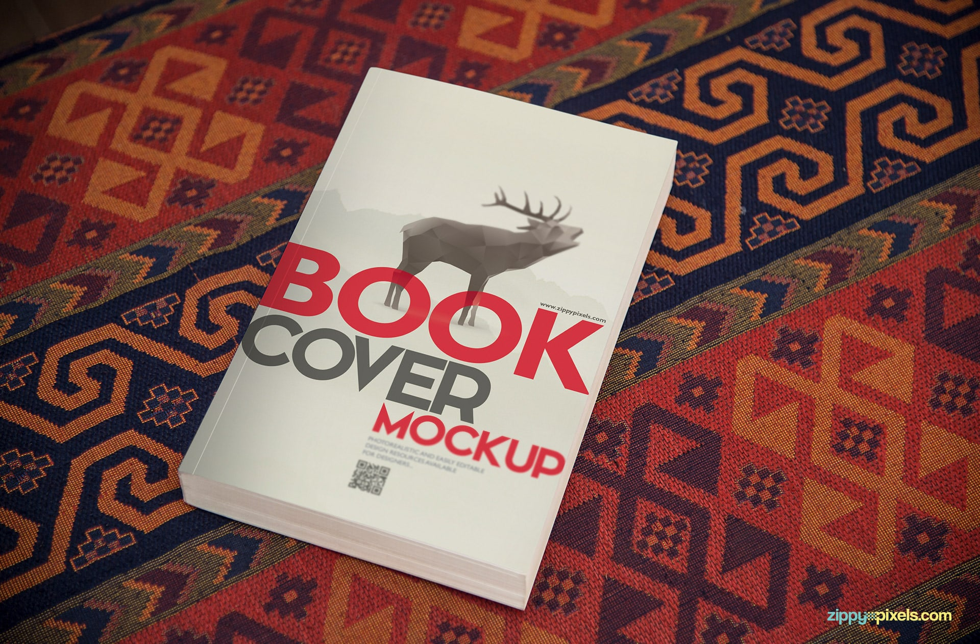 Cover mockup of softcover book lying on beautiful patterned surface