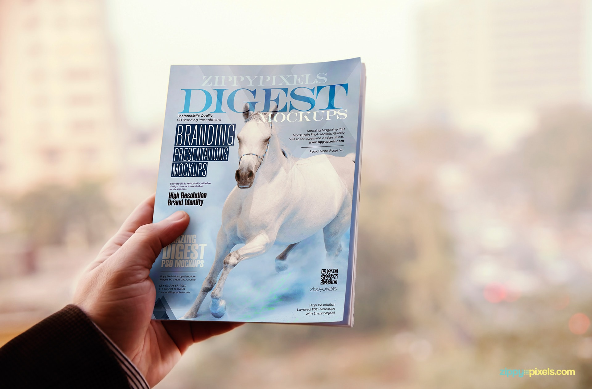 free-digest-magaine-cover-mockup-in-hand
