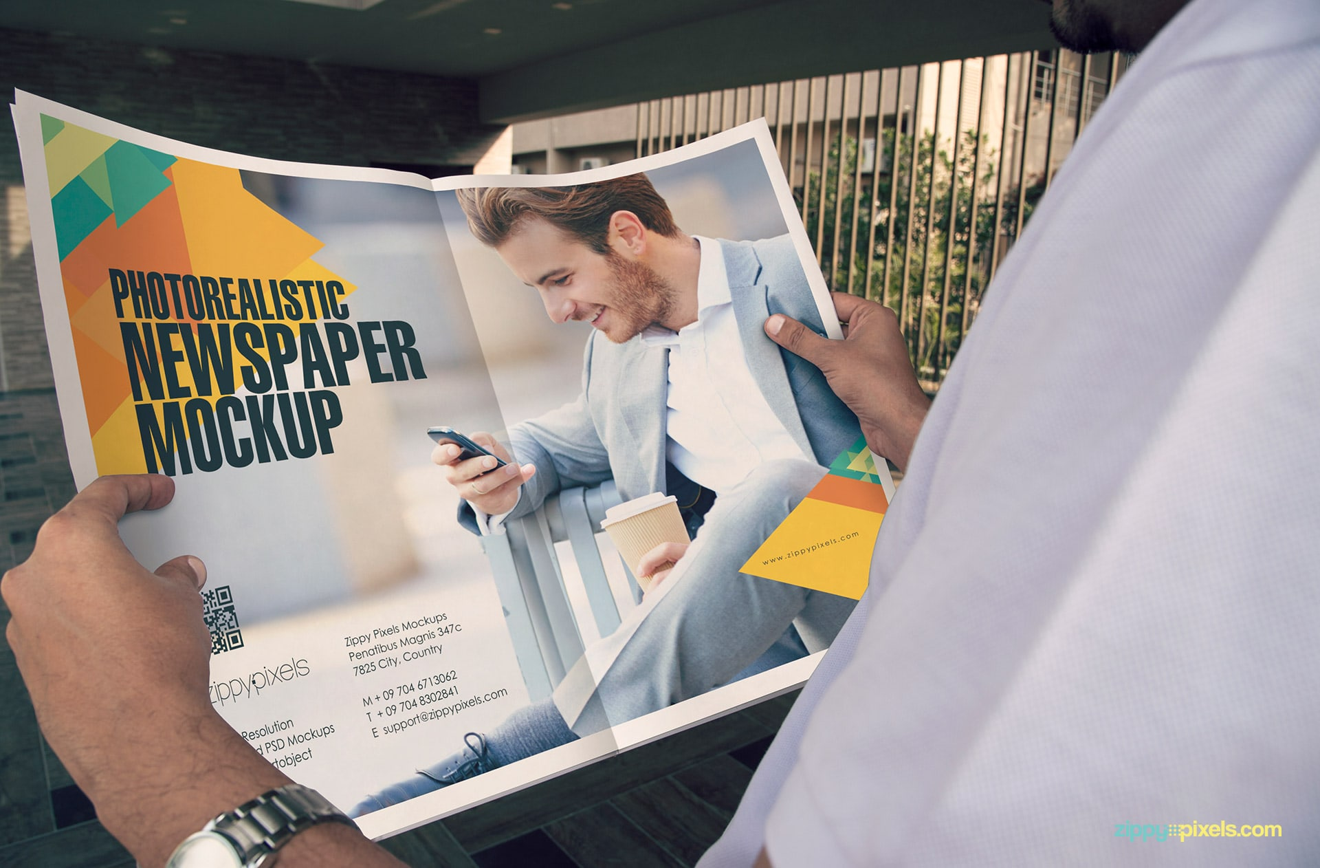 newspaper ad mockup showing person holding newspaper in hands showing 2 page double truck ad