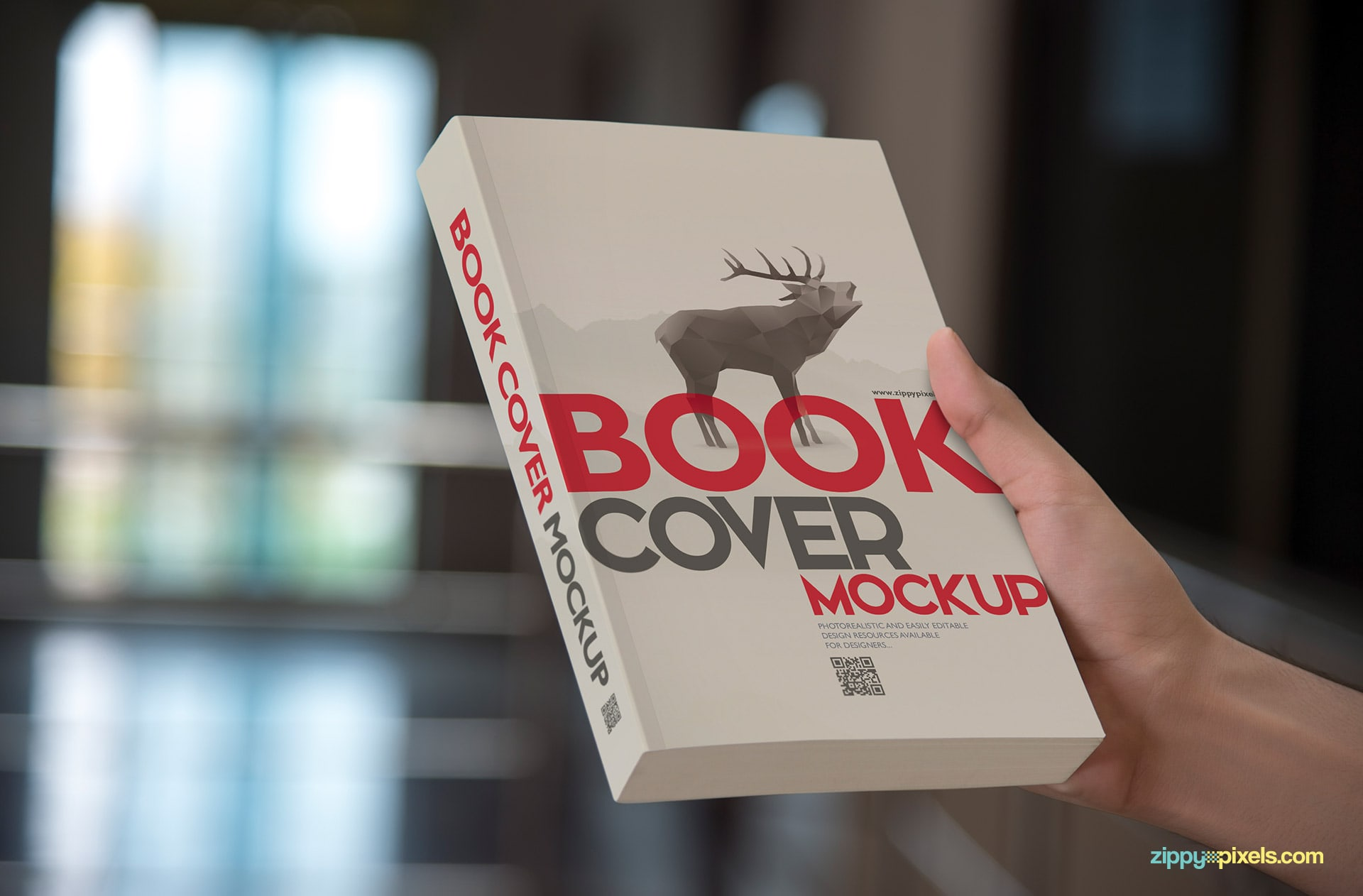 Photorealistic paperback mockup showcasing book held vertically to show front cover design