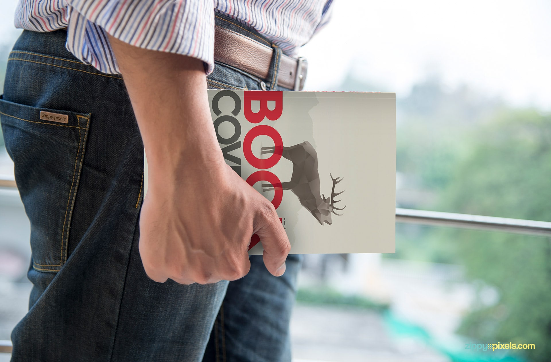 Soft cover book mockup showcasing a person carrying paperback book