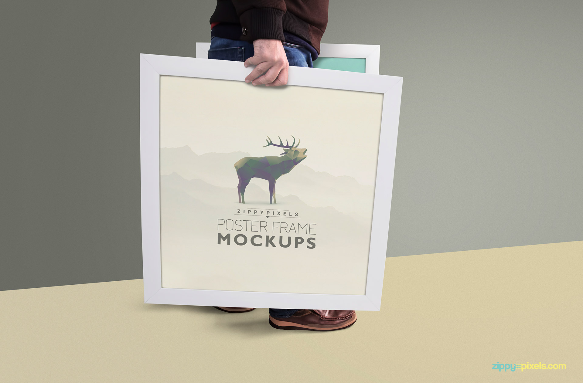 Poster Frame Mockup showing person holding sqaure frame in hands