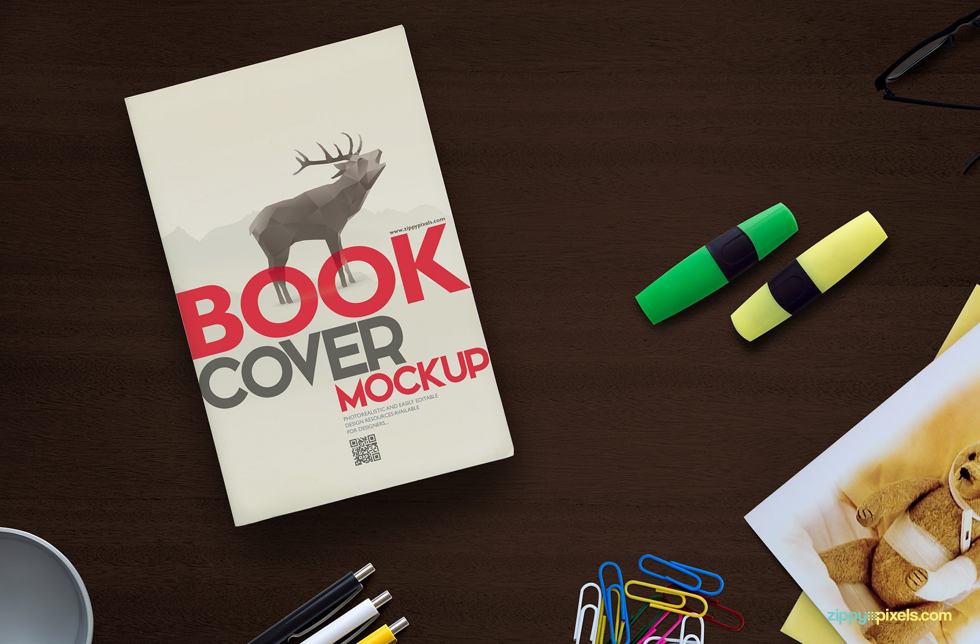 Book cover mockup psd with a pair of highlighters, bunch of paperclips, three pens, pen holder & greeting card