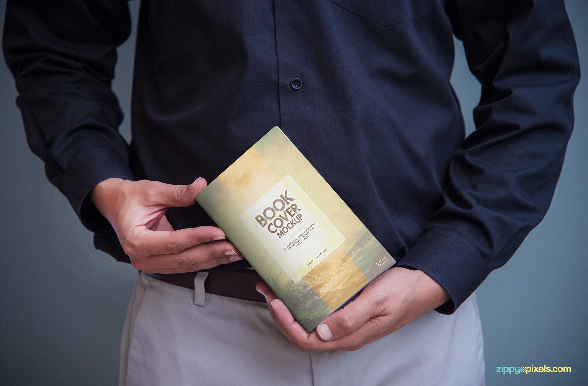 Realistic Book mockups showing a person holding a softcover book in hands to showcase cover design