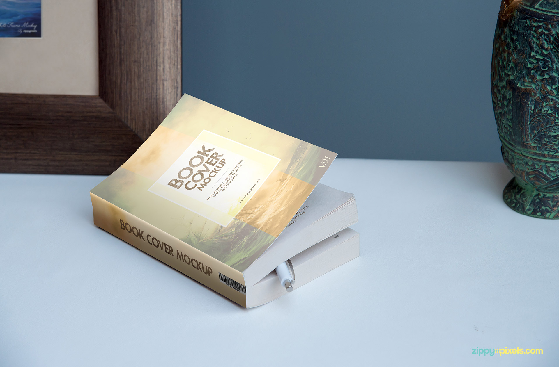 Softcover Novel mockup showing a book lying down with pen inside it