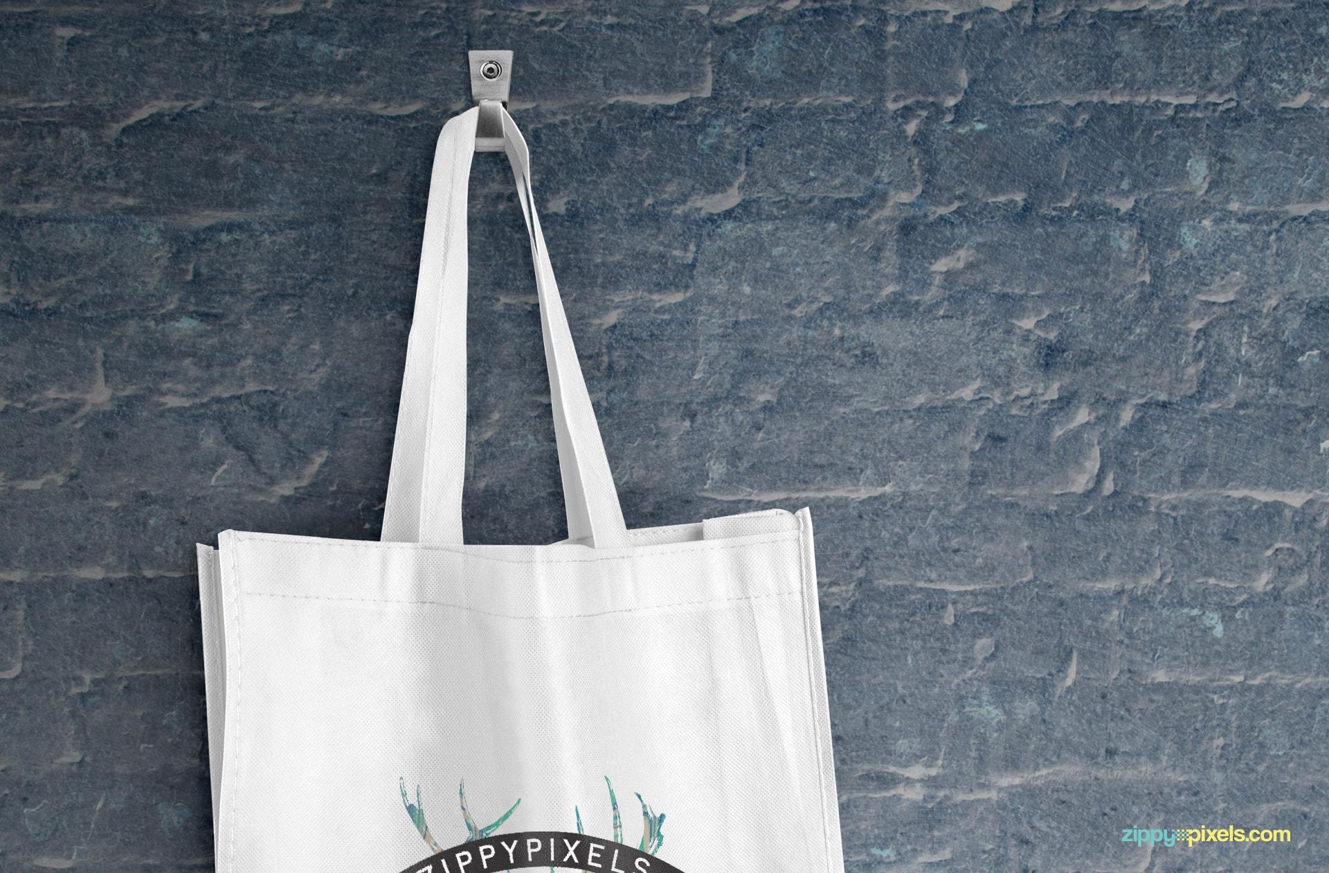 Close-up shot of hanging tote bag PSD mockup