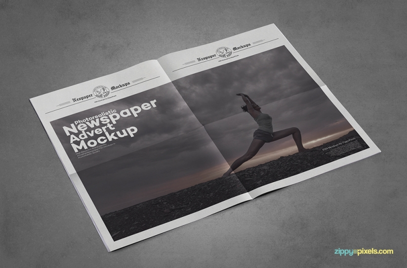 full spread newspaper advert mockup