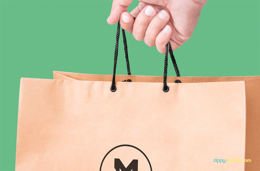 free handheld paper bag mock-up