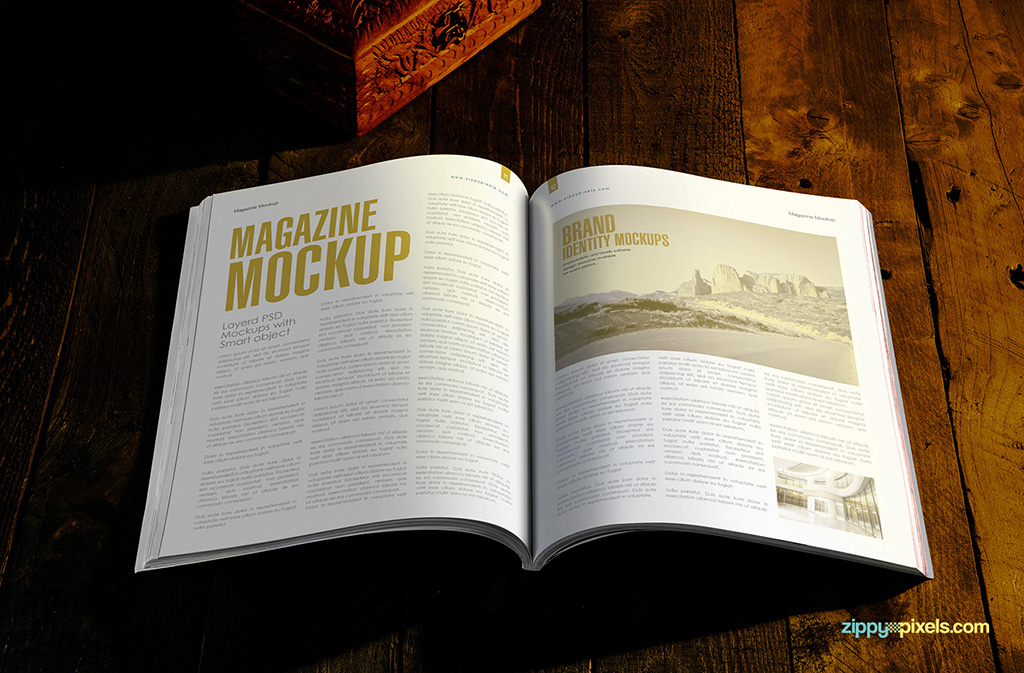 spread view of the magazine mockup psd with gold foil effect