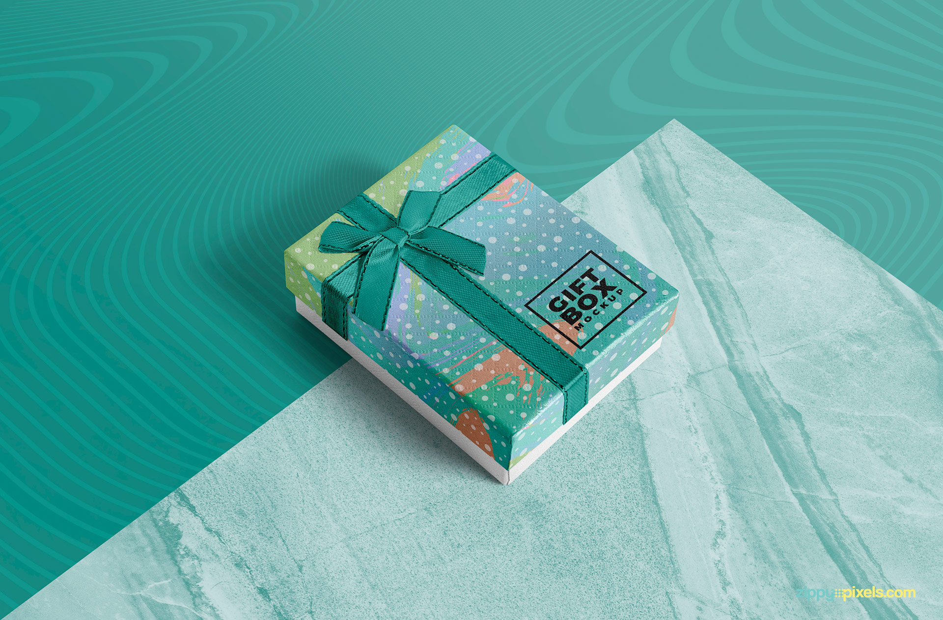Free gift box mockup with a customizable marble base.