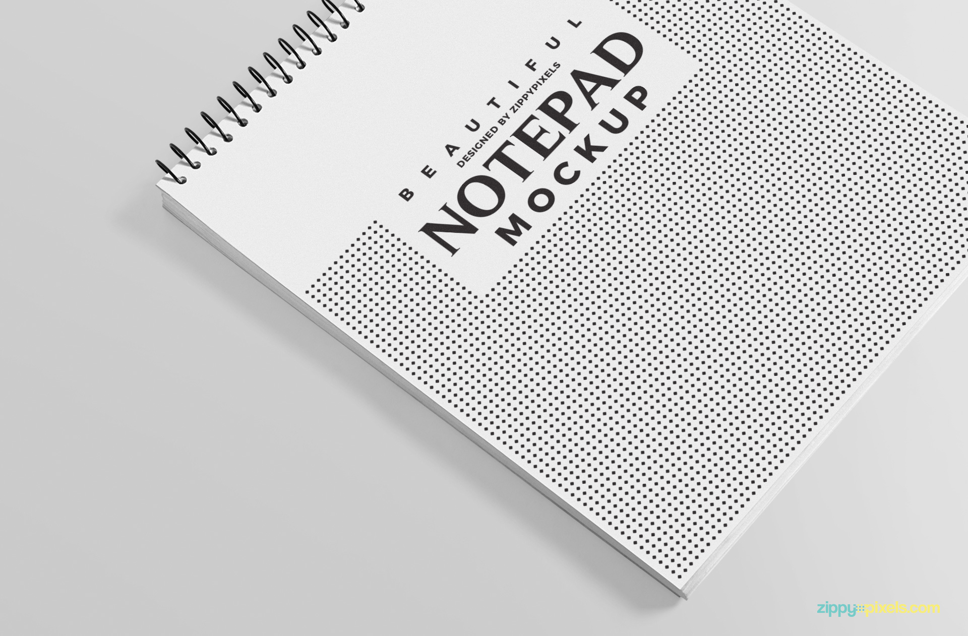 This spiral notepad mockup is available in PSD format.