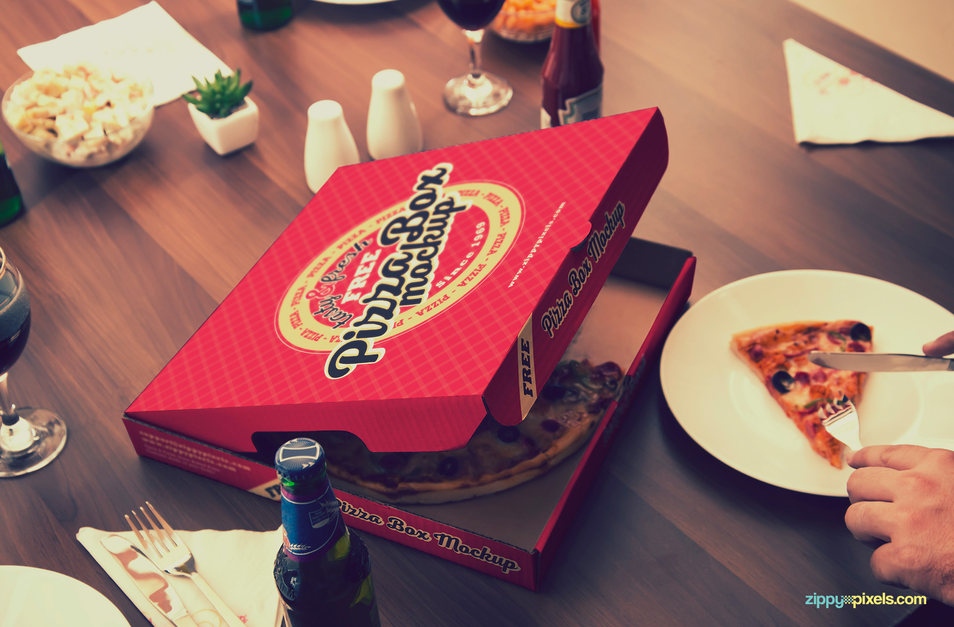 Free pizza mockup with whole dining table scene.
