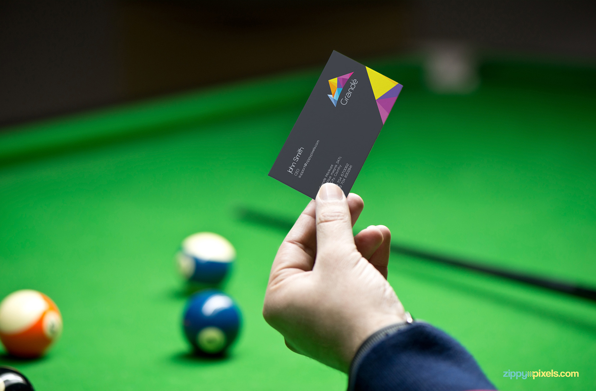 Free and easy to use realistic business card mockup with a pool table background.