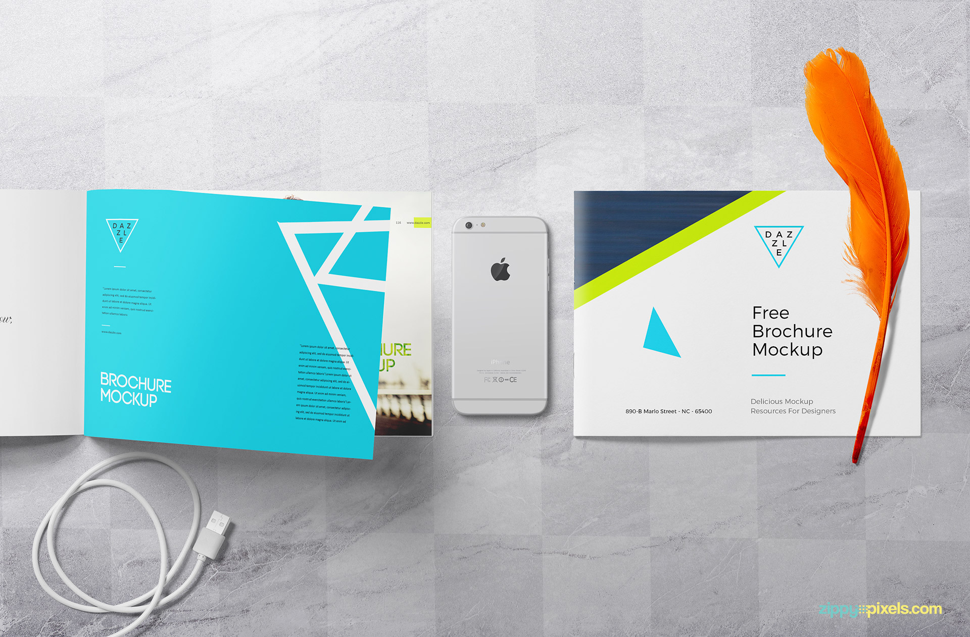 Free brochure mockup scene with iPhone, feather and data cable.