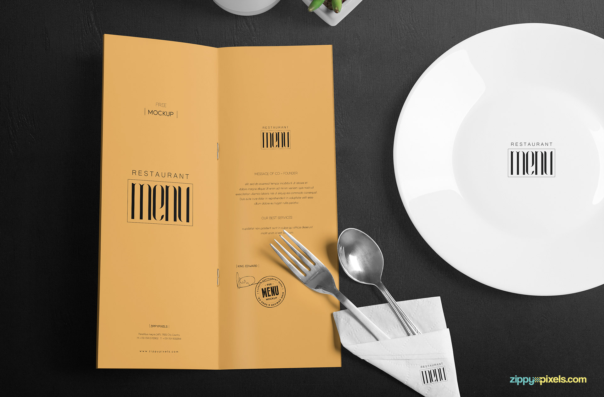A complete dining table scene with the menu card, plate, cutlery and artificial plant pot.