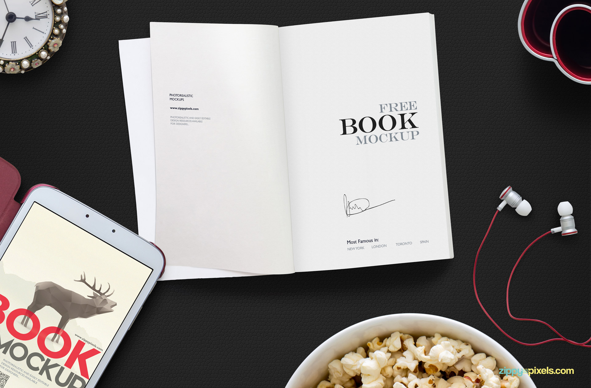 An open book mockup scene along with tablet, popcorn bowl, hands-free, clock and pen holder.