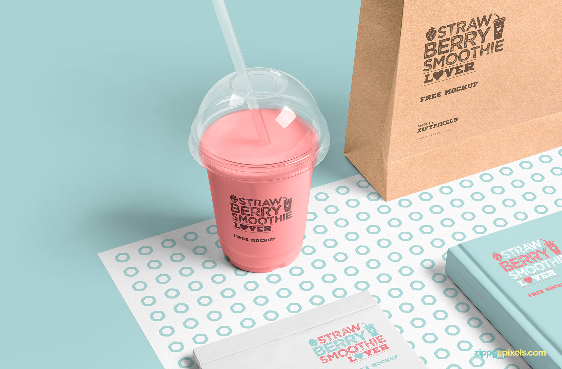 Free plastic cup mockup scene includes transparent cup, book, notepad and shopping bag.