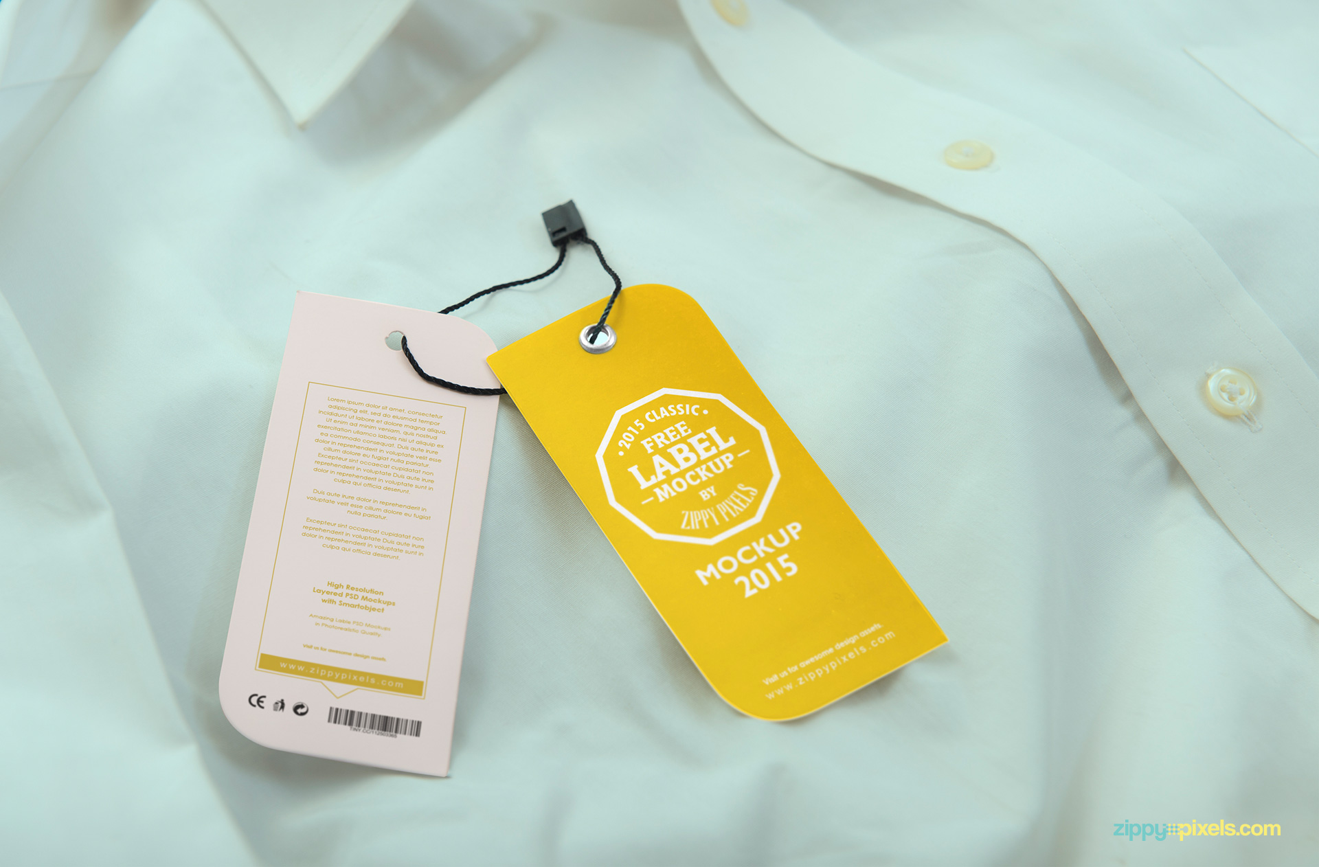 Clothing tags with front and back preview placed on the shirt.