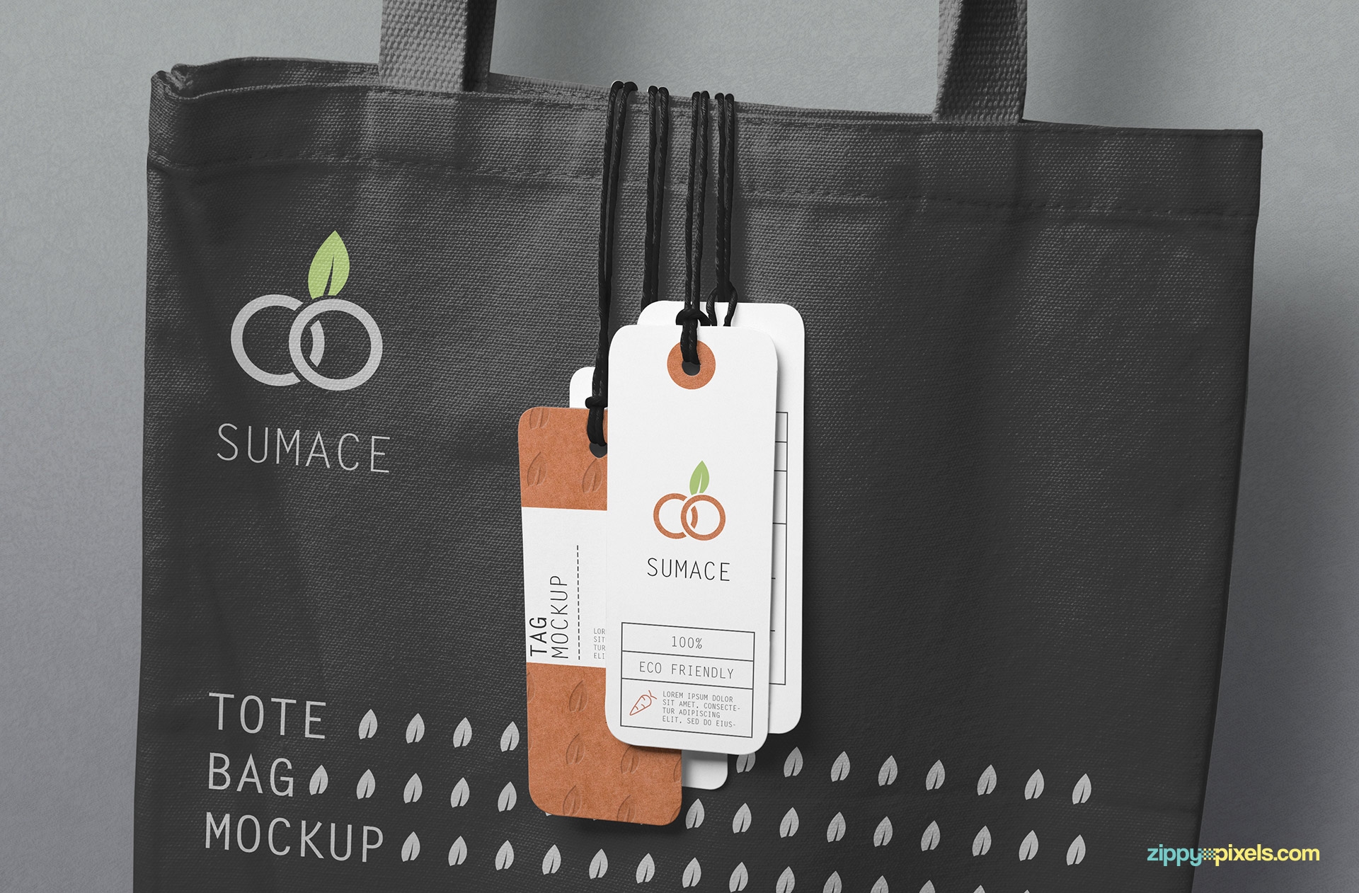 4 tags hanging on a customizable tote bag.