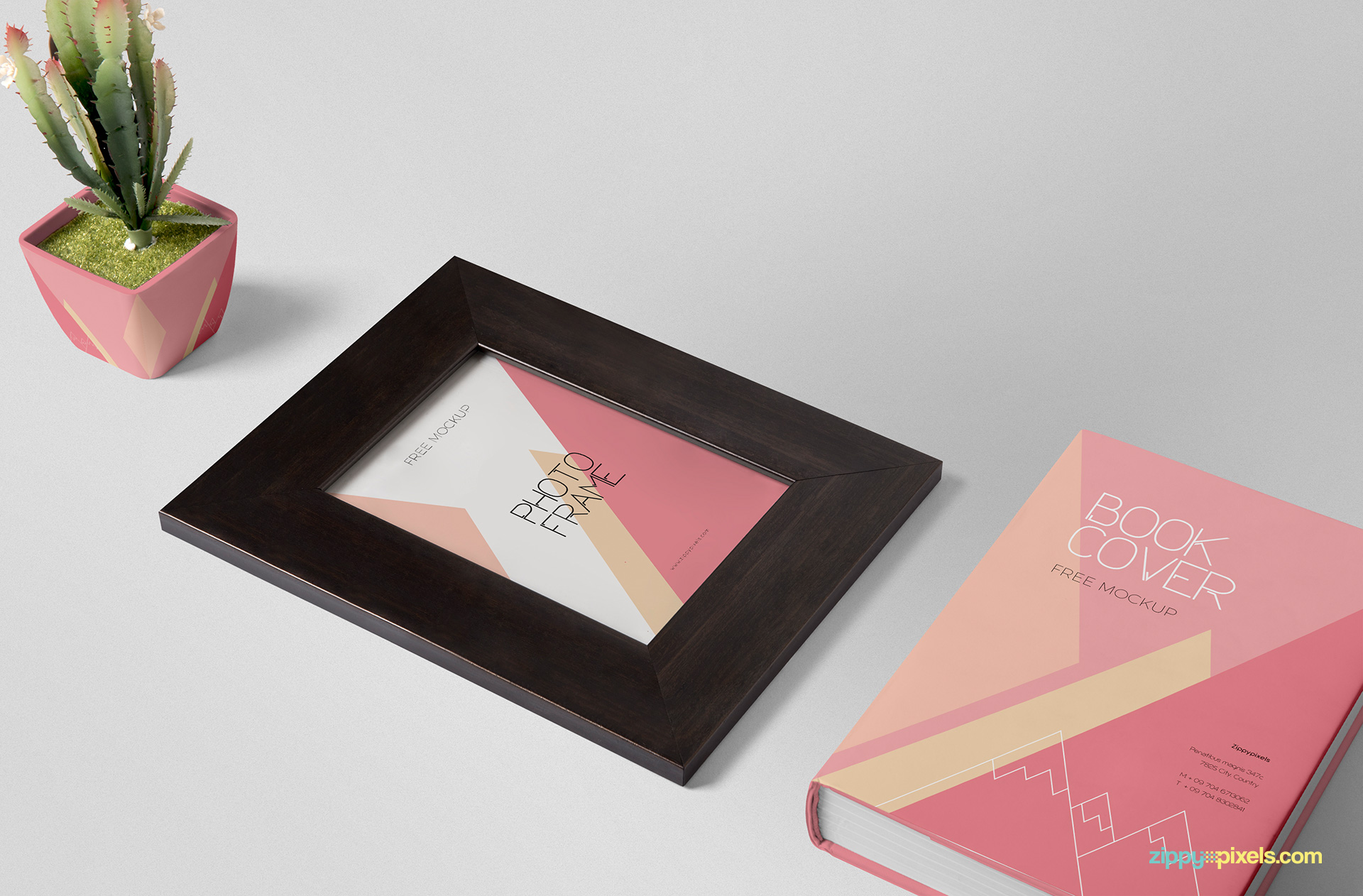 Frame mockup PSD scene including a picture frame, plant pot and book cover.