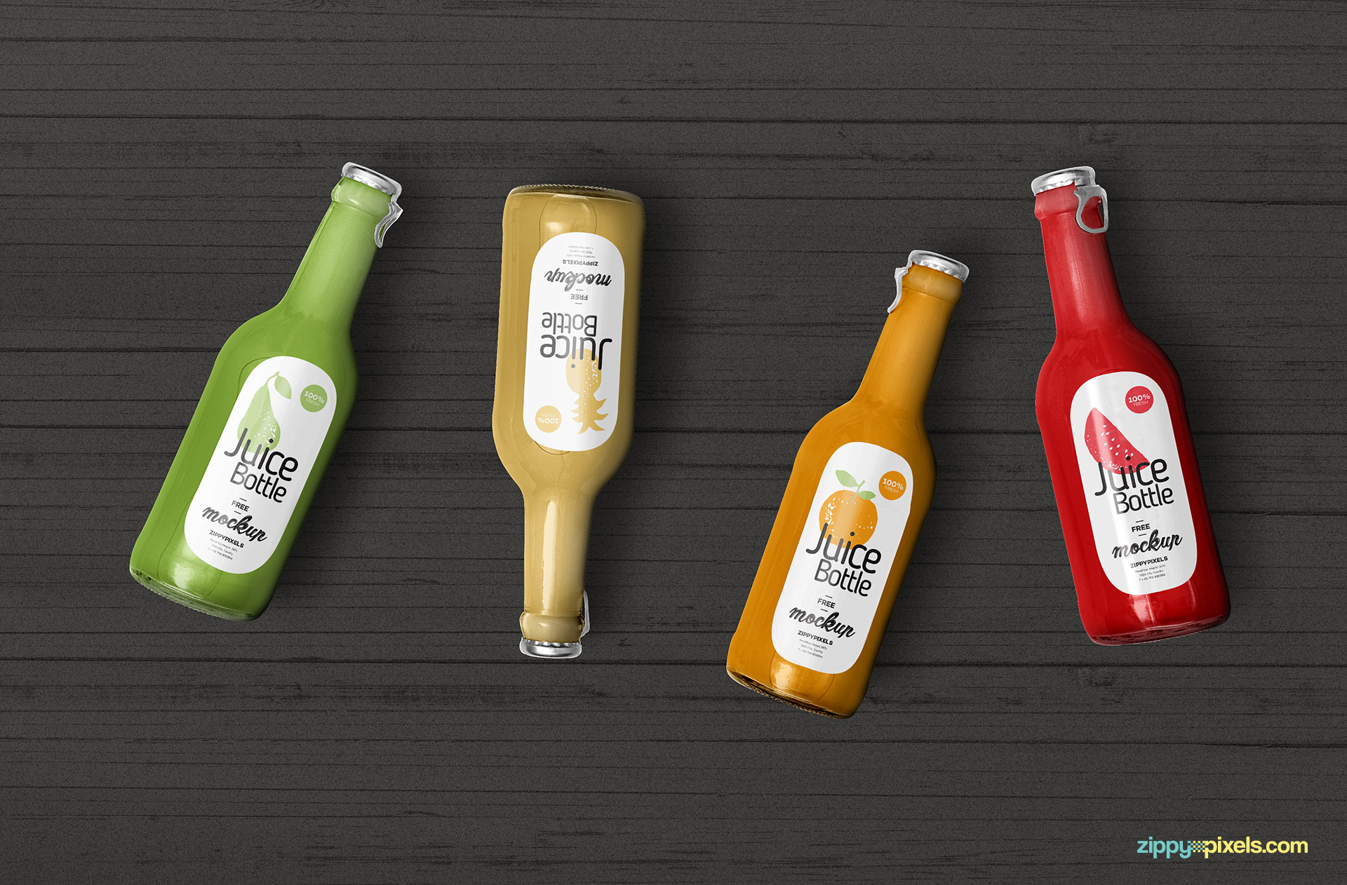 4 juice bottles placed on wooden background.